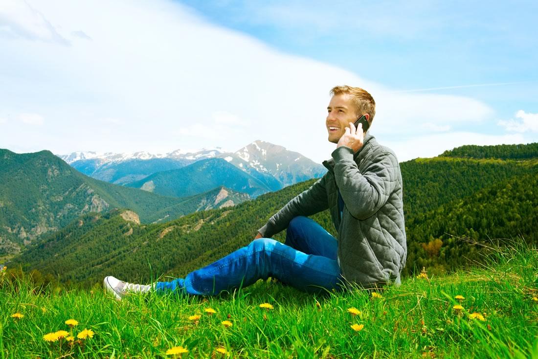 photodune-8099873-casual-wearing-man-talking-on-cellphone-outdoor-mountains-m